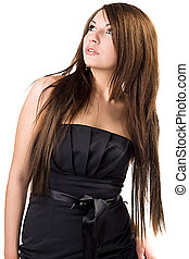 The beautiful young woman in black dress. Isolated