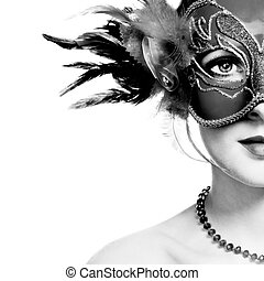 The beautiful young woman in mysterious venetian mask
