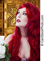 The beautiful young woman red haired in mysterious medieval room