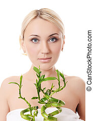 The beautiful young woman with a green bamboo