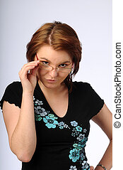 The beautiful young woman with glasses