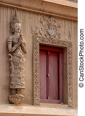 The beauty of Thai architecture and Angel statue at Scripture Repository Wat Phra Singh, Chiang Mai.