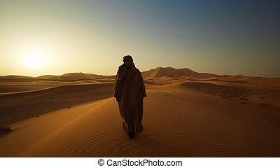 The Bedouin is walking through the desert
