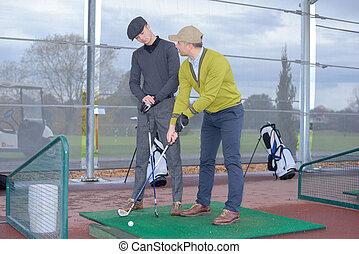 the beginner hitting golf ball