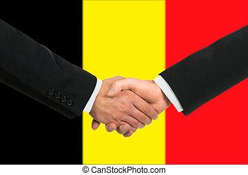 The Belgian flag and business handshake