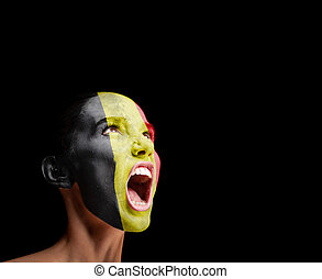 The Belgian flag on the face of a screaming woman. concept