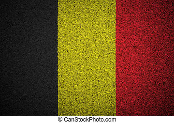 The Belgian flag painted on a cork board.