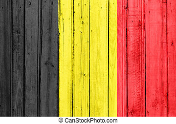 The Belgian flag painted on a wooden fence
