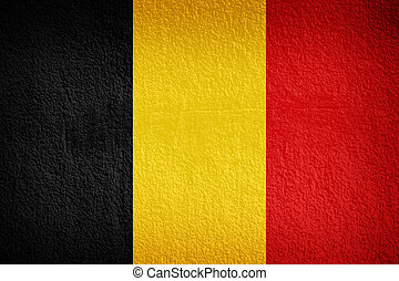 The Belgian flag painted on grunge wall
