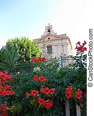 The bell tower and flowers