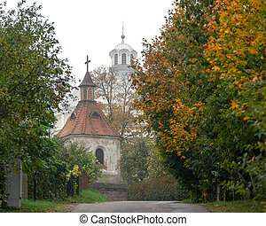 The bell tower of the old church in fall
