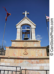 The bell tower, topped by a cross