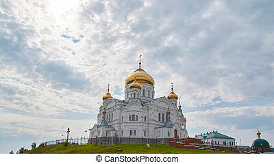 the Belogorsky monastery on the background of blue sky with clouds.