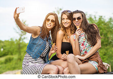 The best friends. Selfie - Three beautiful woman eating ice cream in the City