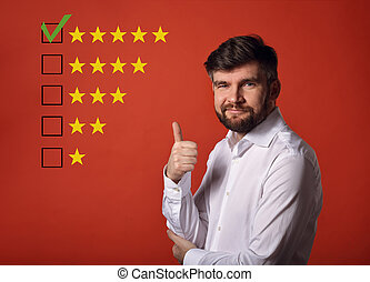 The best rating, evaluation, online rewiew. Happy bearded business showing the hand thumb up  in white shirt on red background with empty space background