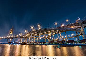 The Bhumibol Bridge (also known as the Industrial Ring Road Bridge) at night, Bangkok, Thailand