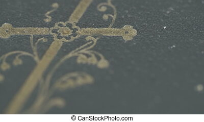 The bible with a cross on the cover