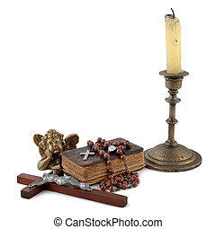 the bible with beads, an angel and candles 2