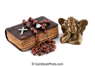 the bible with beads and an angel