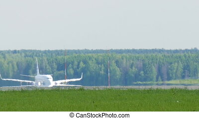 The big beautiful airliner landed. Roll along the runway to the parking lot, for unloading passengers.