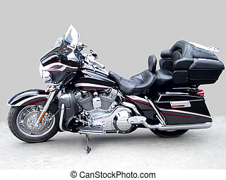 The big black brilliant motorcycle on a grey background, a ...