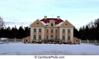 The big cream-colored old manor house in Estonia Baltic with...