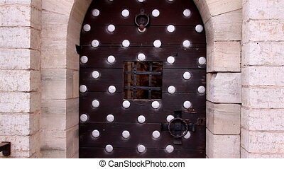 The big metal door of the old castle - The big metal door...