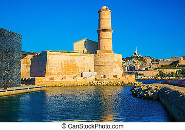 The big watchtower is reflected in blue water of the...