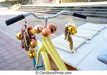 The bike is decorated with Christmas balls and fir cones