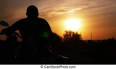 The biker at sunset - The biker turns to the right at sunset...