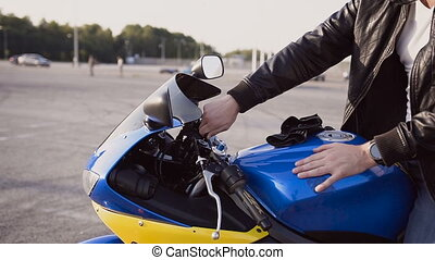 The biker launches its engine in a motorcycle
