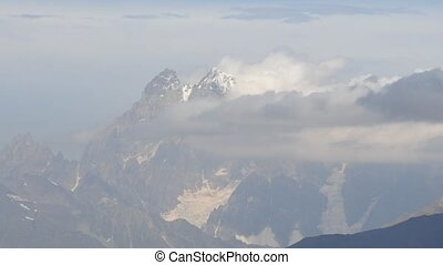 The birth of clouds around mountain peaks, time lapse, Ushba