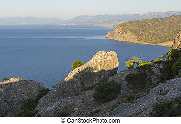 The Black Sea coast. Sunny morning. View to the west from the top of the Karaul-Oba. Novyy Svet, Crimea.