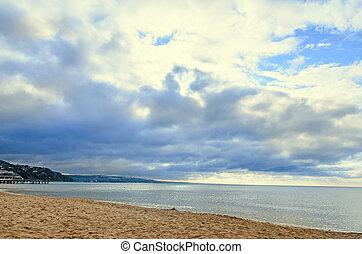 The Black Sea shore from Albena, Bulgaria with golden sands, sun, blue mystic water, green coastline