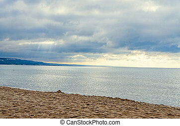 The Black Sea shore from Albena, Bulgaria with golden sands, sun, blue mystic water, green coastline
