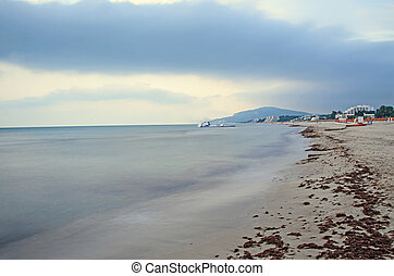 The Black Sea shore from Albena, Bulgaria with golden sands, sun, blue mystic water, seaside bridge near hotels