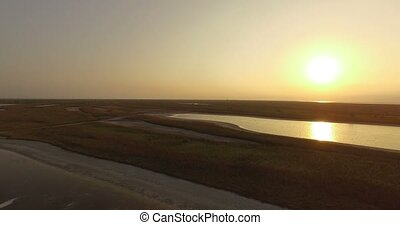 The Black Sea Shore With Patches of Brownish Wetland at a Splendid Sunset