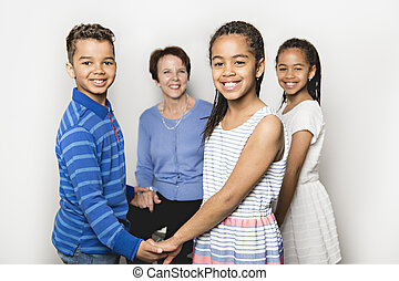 black twin girls and boy child with grandmother in studio white background