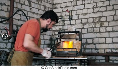The blacksmith places the item in the oven, in the forge