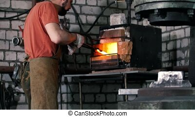 The blacksmith pulls out fire metal detail