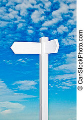The Blank of sign direction isolated on blue sky background