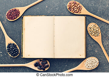 blank recipe book and various legumes