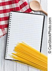 blank recipe book with italian spaghetti