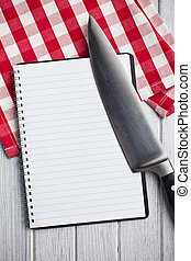 blank recipe book with kitchen knife