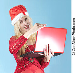 The blonde in a New Year's hat  with  red laptop