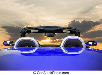 The blue car with sunset
