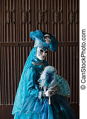 The blue lady in the carnivalesque costume
