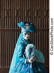 The blue lady in the carnivalesque costume and venetian mask