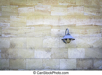 The blue lamp on the brick wall