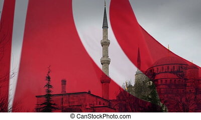 the blue mosque in istanbul, with turkish flag blowing...